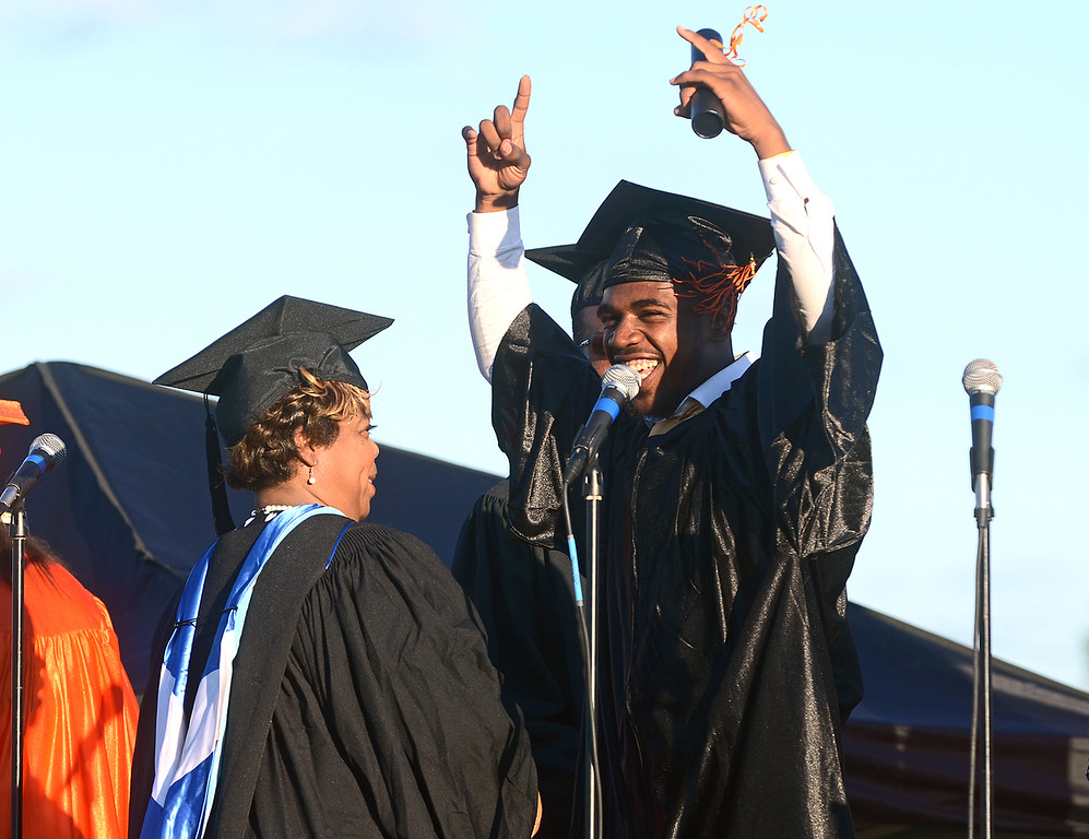 Description of . Robert Carter celebrates while walking across the stage during Chester High School's graduation ceremony, Friday. (Times Staff / JULIA WILKINSON)