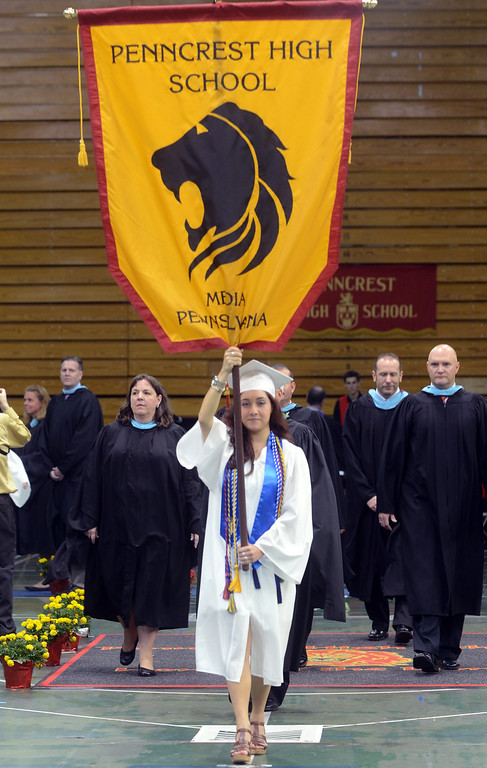 Description of . Angela Anastasi holds the Penncrest High School flag during the opening procession during commencement at Villanova University, Thursday. (Times Staff / JULIA WILKINSON)