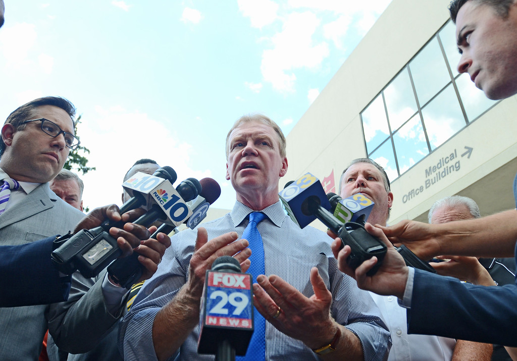 Description of . Delaware County District Attorney Jack Whelan speaks to the press for the second time Thursday after police say a man opened fire at the Sister Marie Lenahan Wellness Center in Yeadon on the campus of Mercy Fitzgerald Hospital. (Times Staff / JULIA WILKINSON)