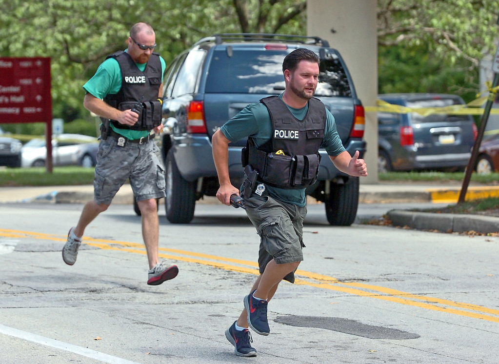 Description of . Police respond to the scene of a shooting at the Sister Marie Lenahan Wellness Center in Yeadon on the campus of Mercy Fitzgerald Hospital Thursday. (Times Staff / JULIA WILKINSON)
