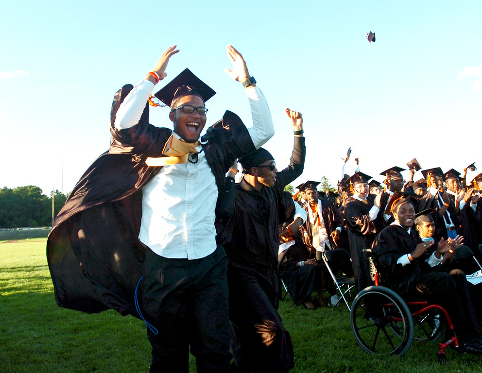 Description of . Students celebrate at the end of the commencement ceremony at Chester High School Athletic Field, Friday. (Times Staff / JULIA WILKINSON)