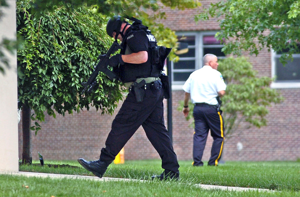 Description of . Police responding to the scene of a shooting at the Sister Marie Lenahan Wellness Center in Yeadon on the campus of Mercy Fitzgerald Hospital Thursday. (Times Staff / JULIA WILKINSON)