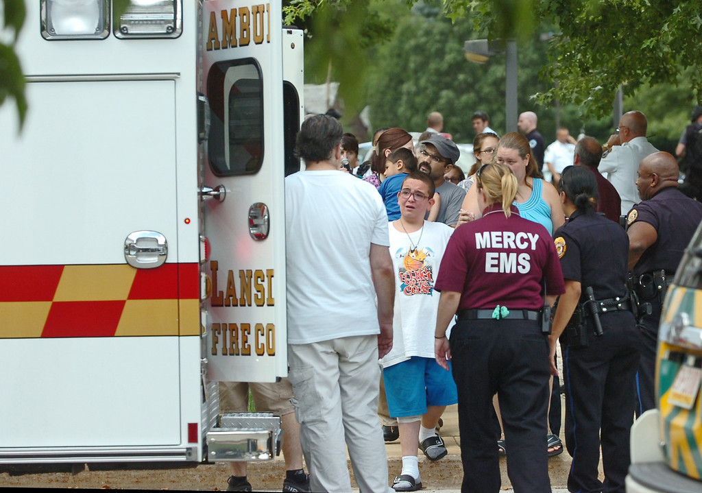 Description of . People are evacuated from the Sister Marie Lenahan Wellness Center in Yeadon on the campus of Mercy Fitzgerald Hospital after police say a man opened fire Thursday. (Times Staff / JULIA WILKINSON)
