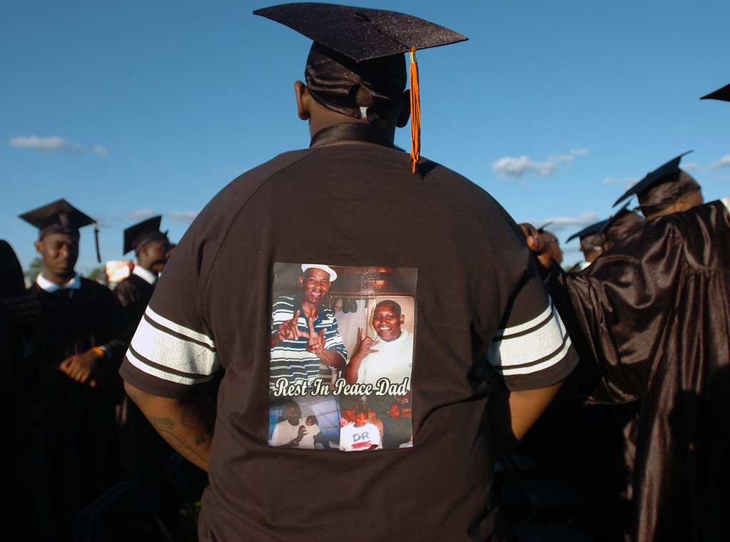 Description of . Deshawn Watson displays a shirt he wore under his gown in memory of his father who passed away last year at Chester High School's graduation, Friday. (Times Staff / JULIA WILKINSON)