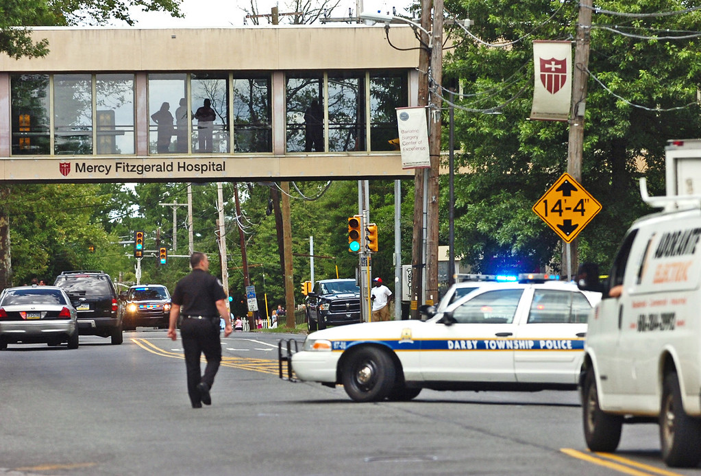Description of . Police  direct traffic on Lansdowne Avenue after a shooting in the Sister Marie Lenahan Wellness Center in Yeadon on the campus of Mercy Fitzgerald Hospital Thursday. (Times Staff / JULIA WILKINSON )