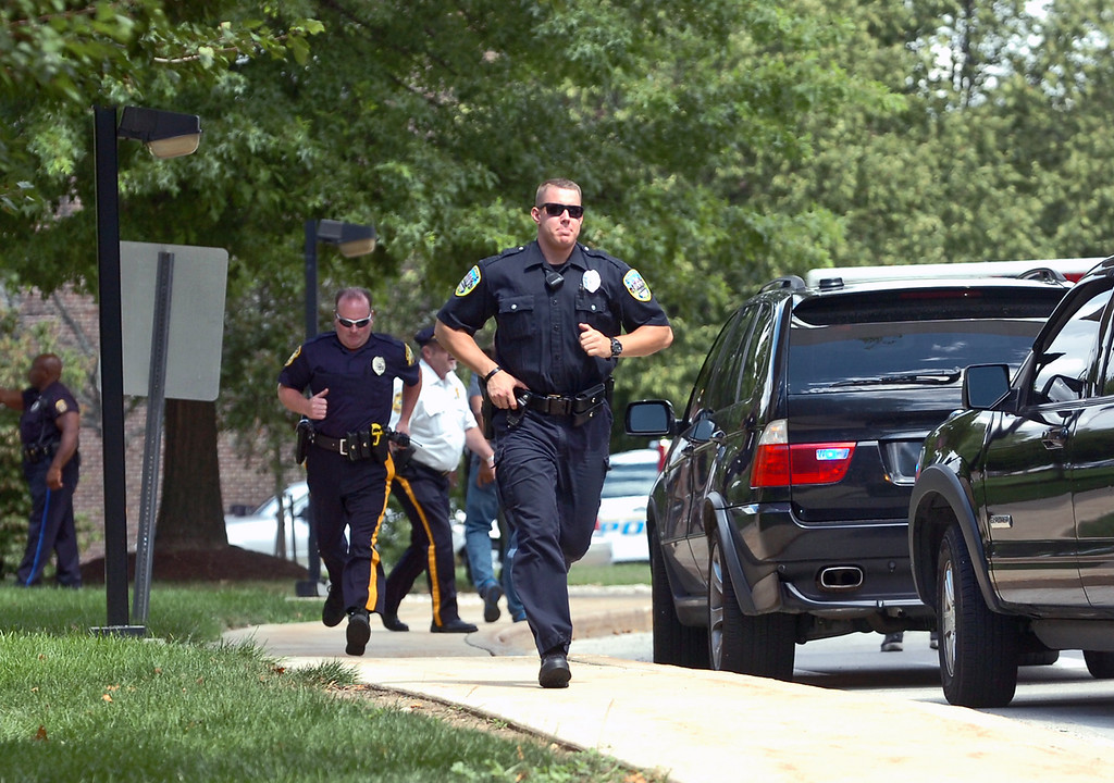 Description of . Police responding to the scene of a shooting at the Sister Marie Lenhan Wellness Center in Yeadon on the campus of Mercy Fitzgerald Hospital Thursday. (Times Staff / JULIA WILKINSON)