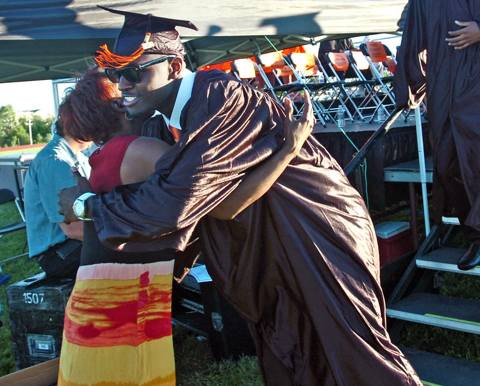 . Da\'Saun Campbell hugs library assistant Sharon Young while walking off the stage during the Chester High School graduation ceremony, Friday. (Times Staff / JULIA WILKINSON )