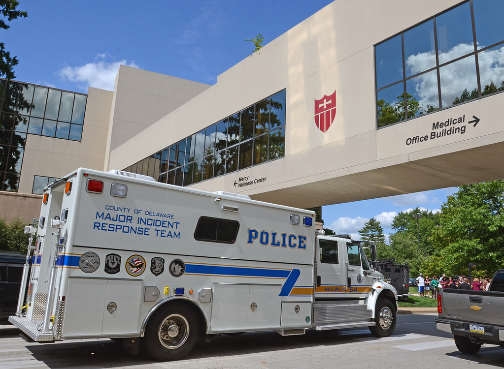 . A police vehicle responds to the scene of a shooting at the Sister Marie Lenahan Wellness Center in Yeadon on the campus of Mercy Fitzgerald Hospital Thursday. (Times Staff / JULIA WILKINSON)