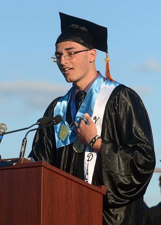. Chester High School valedictorian Felix Revera gives his speech during the graduation ceremony, Friday. (Times Staff / JULIA WILKINSON)