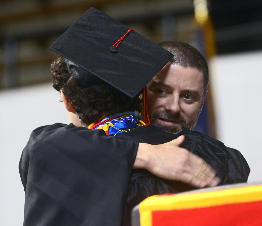 ". Penncrest High School salutatorian Ethan Craig shares a moment with physics teacher Jim ""Chic\"" Ciccarelli after giving his speech about someone who inspires him, during commencement at Villanova University, Thursday. (Times Staff / JULIA WILKINSON )"